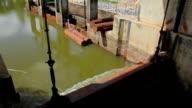 Flowing water at floodgate,Tilt Down video