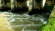 Flowing water at small dam. video
