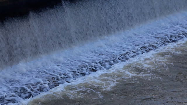 Flowing water at small dam video