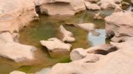 Flowing Water Through Vintage Stone At Sam Phan Bhok video