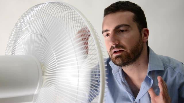 Flushed man feeling hot video