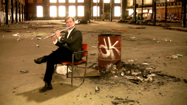 Flutist in an abandoned factory. video