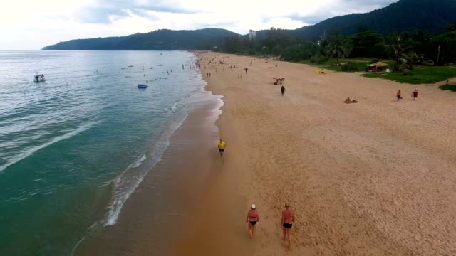 PHUKET, THAILAND - 20 JAN 2017: Fly away from the beach at cloudy day in Phuket, Thailand video
