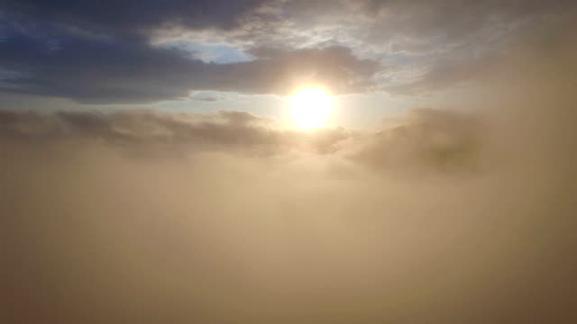 fly out from the cloud to the delightful view of the setting sun video