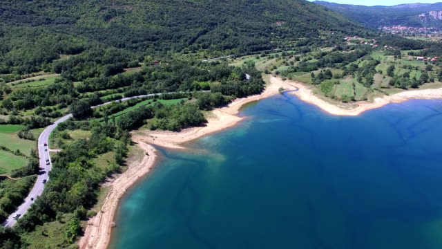 Flying above beautiful landscape of artificial lake of Peruca, Croatia video
