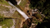 AERIAL: Flying above beautiful large waterfall in rocky mountains video