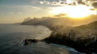 Flying above Copacabana Beach with warm sunset sky, Rio de Janeiro video