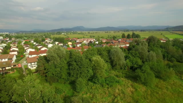 AERIAL: Flying above cute luxury suburban row houses village on a beautiful sunny day video