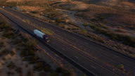 AERIAL: Flying above freight semi truck transporting goods on busy highway video