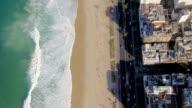 Flying above Ipanema Beach iconic sidewalk, Rio De Janeiro, Brazil video