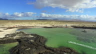 AERIAL: Flying above lots of kitesurfers kiteboarding in flat lagoon video