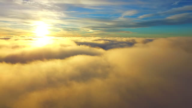 Flying above real clouds with a drone video