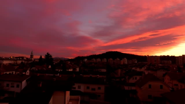 AERIAL: Flying above the homes and houses in small city at beautiful sunset video