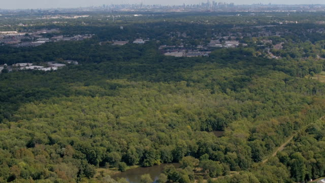 AERIAL: Flying above the luxury suburbs towards the famous New York City skyline video