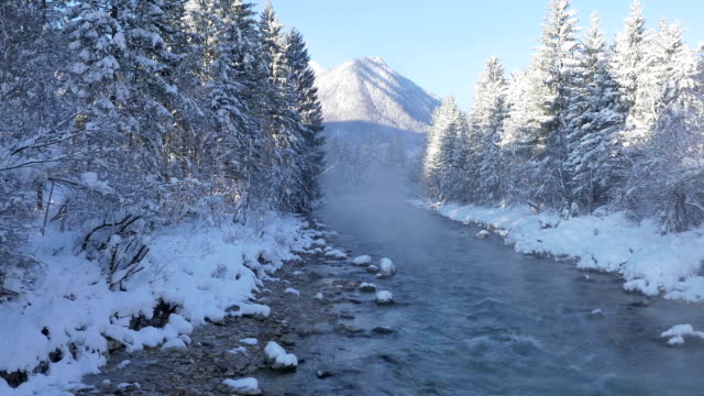 AERIAL: Flying above the misty river in winter morning video