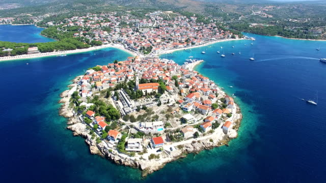 Flying above traditional dalmatian houses on Primosten peninsula, Croatia video