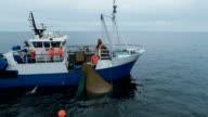 Flying Around Commercial Fishing Ship with Trawl Net full of Fish video