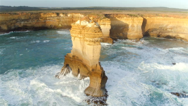 AERIAL: Flying around high limestone formation rising from shallow water video