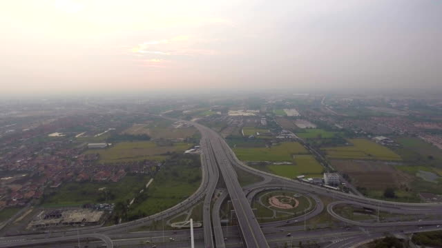 Flying around stacked highway with traffic and circle in Bangkok Thailand, Aerial view video