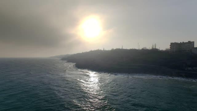 Flying away from dark island aerial video