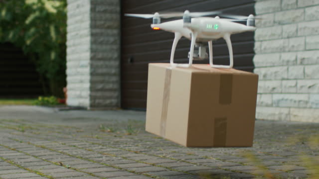 Flying Drone Delivers Postal Package Right To Your Porch. video