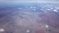 AERIAL: Flying high above bend watercourse of river in arid desert landscape video