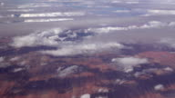 SLOW MOTION: Flying high above pollution clouds over the vast red sand desert video