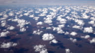 AERIAL: Flying high above white clouds and amazing Great Victoria Desert video