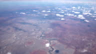 AERIAL: Flying high over winding zigzag course of river in dry desert landscape video