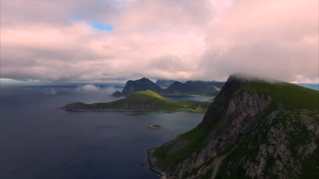 Flying in clouds by the cliffs on Lofoten islands, Norway video