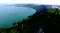 Flying low over the Beautiful Lake Travis Bend near the Oasis overlooking the Turquoise blue waters in the Texas Hill Country Austin Texas video