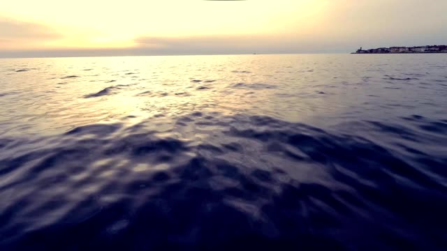 flying low over the mediterranean sea by sunset video