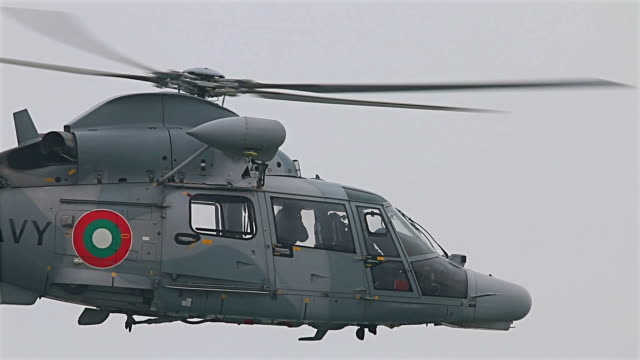 Flying military helicopter with navy seals training for terrorism battle in the sea video