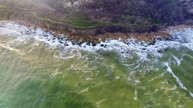 Flying near coast aerial video