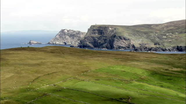 Flying North Past Glencolumbkille Bay  - Aerial View - Ulster, Donegal, Ireland video