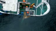 Flying over a Commercial Ship Fishing with Trawl Net at the Sea. video