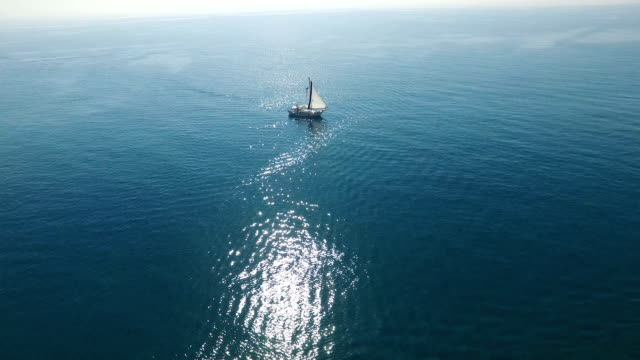 Flying Over A Sailing Boat In The Open Sea video