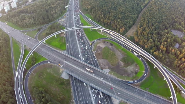 Flying over city traffic on transport intersection video