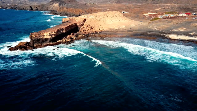 Flying over cliff in La Pared, Fuerteventura, Canary Islands. video