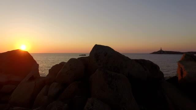 Flying over colorful sardinia mediterranean sea coastline at sunrise video