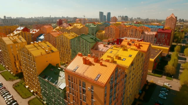 Flying over cozy comfortable colorful buildings in a European city 4K UHD aerial video