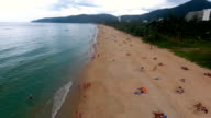 PHUKET, THAILAND - 20 JAN 2017: Flying over empty beach and few people walking and having sunbath on the beach video
