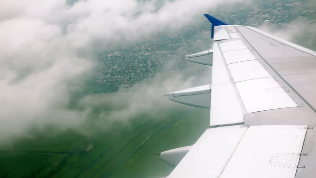 Flying over fields and clouds video
