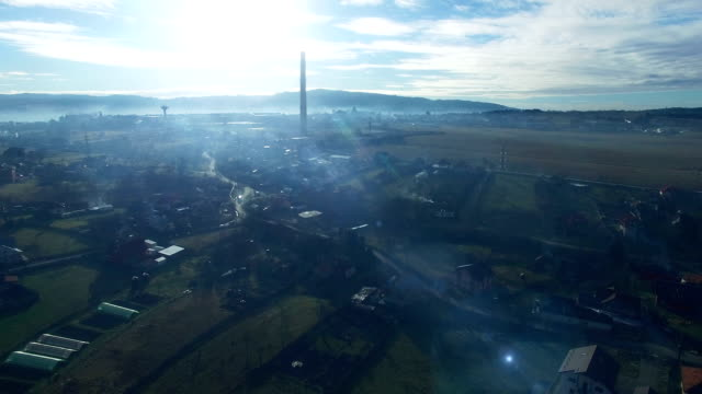 Flying over fields at countryside, blue tint video