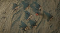 Flying over Group of Dead Soldiers in Desert Area. Zooming In. video