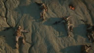 Flying over Group of Dead Soldiers in Desert Area. Zooming Out. video