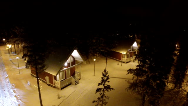 Flying over guest houses in winter holiday village video