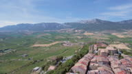 Flying over Laguardia Old Town with vineyards and mountains, Spain video
