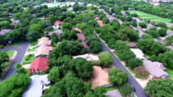 AERIAL: Flying Over Local Austin Texas Housing Complex with natural Trees and Texas Hill Country feel video