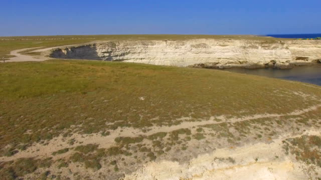 Flying over plateau towards white costal cliffs, aerial video video